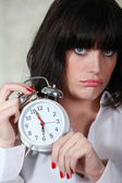 A cranky woman in the morning — Stock Photo