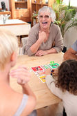 Family playing a board game — Stock Photo