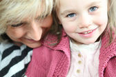 Portrait of grandmother with granddaughter — Stock Photo