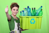 Woman recycling plastic bottles — Stock Photo