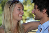 Young couple in love embracing in the sunshine — Stock Photo