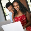 Afro-American couple relaxing at home — Stockfoto