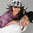 Stock Photo: Happy couple wearing hats and fooling around