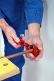 Plumber with a pipe cutter — Stock Photo