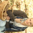 Womwith basket in field — Stock Photo #18431357
