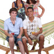 Stock Photo: Teens on a hammock