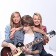 Teenagers with guitar — Stock Photo