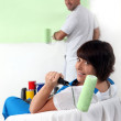 Couple painting a wall — Stock Photo #18435867
