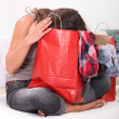 Woman with head in bag - Stock Photo