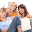 Three young woman returning home from a shopping trip — Stock Photo