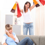 Two teenage girls having fun at home — Stock Photo