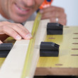 Stock Photo: Close-up of a man with tape measure