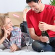 Couple drinking champagne in new home — Stock Photo #18436333