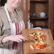 Woman preparing vegetables — Stock Photo