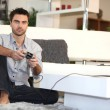 Man playing video games alone — Stock Photo #18437231