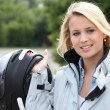 Young woman with helmet for motorcycle - Stockfoto
