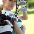 Stock Photo: Woman with golf clubs