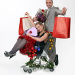Couple with trolley full of Christmas gifts — Stock Photo
