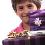 Boy with birthday presents — Stock Photo