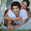 Portrait of couple in tent — Stock Photo #18439327