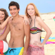 Stock Photo: Three young hanging out on the beach
