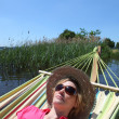 Stock Photo: Womin hammock by lake