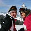 Couple on a skiing trip - Stock Photo