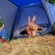 Feet sticking out of a tent — Stock Photo