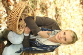Woman with basket in field — Stock Photo