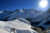 Sun shining on a mountain range — Stock Photo