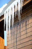 Stalactite hanging from chalet roof — Stock Photo