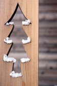 Christmas tree cut out in wood — Stock Photo
