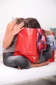 Woman with head in bag — Stock Photo