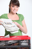 Woman recycling newspaper — Stock Photo