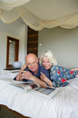 Senior couple resting in bed — Stock Photo
