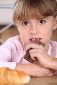 Snacking chocolate girl — Stock Photo