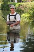 Fisherman wading — Stock Photo