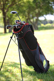 Golf bag replete with clubs — Stock Photo