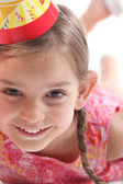 Little girl wearing party hat — Stock Photo
