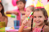 Young girl at a birthday party — Stock Photo