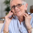 Senior woman talking on the cell — Stock Photo #18441443