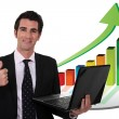 Stock Photo: Businessmwith laptop and upward growth chart