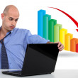 Businessman with a downward chart — Stock Photo #18441689