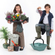 Little girl dressed in florist and a little boy dressed in grape harvester — Stock Photo