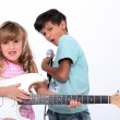 Children in a rock band — Stock Photo