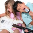 brother and sister practicing musical instruments — Stock Photo
