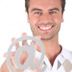 Man holding at symbol — Stock Photo #18442365