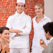 A chef and a waitress working in a restaurant — Stock Photo