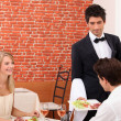 Couple having a romantic dinner in a sexy restaurant — Stock Photo