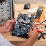 Man working on a circuit board — Stock Photo #18442737